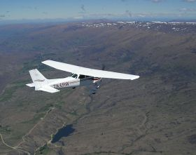 COFC Cessna 172 over Alex, click to view hi-res picture